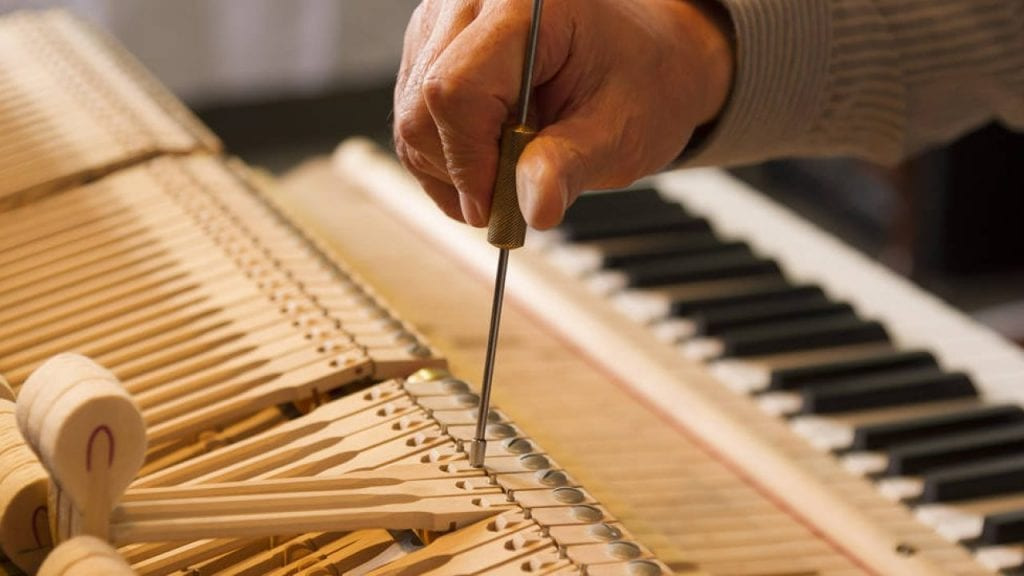 Description: Top Facts Every Pianist Needs To Know About Piano Tuning - Merriam ...